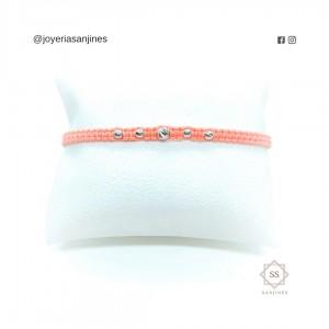 Pulsera rosada tejida con detalles de Oro diamantado de 18k